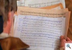 Mozart leyendo partituras
