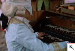 Escena de la película Amadeus: Mozart niño tocando el clave